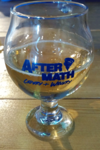 Glass of Aftermath cider