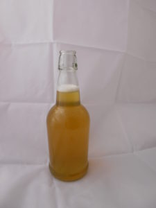 mango serrano pepper mead in a flip top bottle
