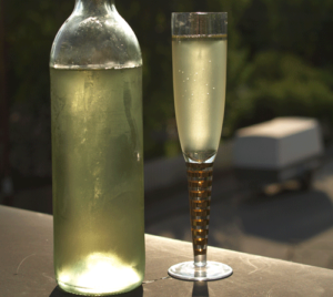 bottle and wine flute with mead